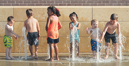 Kick Off a Safe and Healthy Summer - kids splash pad - current balance - marion community credit union